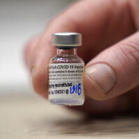 A vial of the Pfizer vaccine for COVID-19 in Seattle, January 24, 2021. (Ted S. Warren/AP)