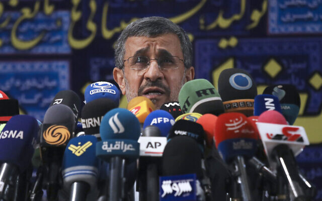 Former Iranian president Mahmoud Ahmadinejad speaks with the media after registering his name as a candidate for the June 18 presidential elections at elections headquarters of the Interior Ministry in Tehran, Iran, May 12, 2021. (AP Photo/Vahid Salemi)