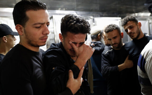 Relatives mourn during the funeral of Reema Telbani and her 5-year-old son Zaid, who were killed in Israeli airstrikes on their family apartment building, at Dar Al-Shifa Hospital in Gaza City on May 12, 2021. (AP/Adel Hana)