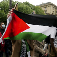 A protester waves a flag during a protest in solidarity with Palestinians, in Paris, Wednesday, May 12, 2021. (AP/Thibault Camus)