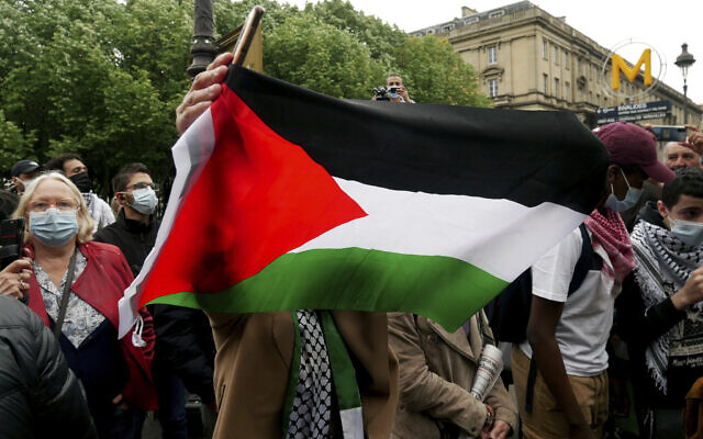 Illustrative: A protester waves a flag during a protest in solidarity with Palestinians, in Paris, Wednesday, May 12, 2021. (AP/Thibault Camus)