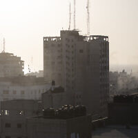 A bomb dropped during an Israeli airstrike falls to hit a building in Gaza City, May 12, 2021.  (Khalil Hamra/AP)
