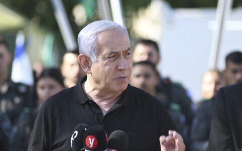 Prime Minister Benjamin Netanyahu meets with Israeli border police on May 13, 2021 in Lod, near Tel Aviv after a wave of violence in the city the night before. (AP/Yuval Chen, Yediot Ahronot, Pool)
