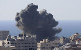 Smoke rises following Israeli airstrikes on a building in Gaza City, Friday, May 14, 2021. (AP/Hatem Moussa)