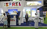 Israeli exhibitors receive visitors at their stand on the opening day of the Arabian Travel Market exhibition, in Dubai, United Arab Emirates, Sunday, May 16, 2021. (AP Photo/Kamran Jebreili)