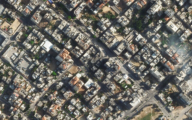 The rubble of a Gaza Strip high-rise building destroyed by the IDF is seen via satellite image, May 16, 2021. (Planet Labs Inc. via AP)