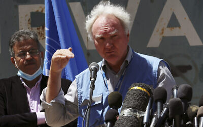 Matthias Schmale, UNRWA's director in Gaza, speaks during a news conference in front of the UNRWA headquarters in Gaza City, Wednesday, May 19, 2021. (AP Photo/Adel Hana)