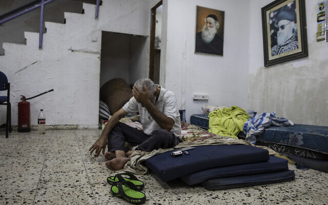 Daniel Turjman, 60, rests in a bomb shelter that is also used as a synagogue near his apartment building in Ashdod, Israel, May 19, 2021 (AP Photo/Heidi Levine)