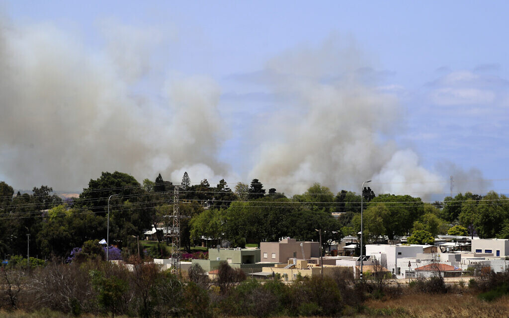 Smoke rises in a community in southern Israel after it was struck by a rocket fired from the Gaza Strip, May 20, 2021. (AP Photo/Ariel Schalit)
