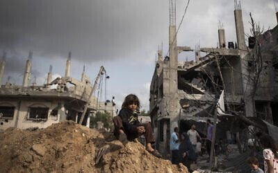 Palestinians inspect the damage to their homes following a ceasefire between Gaza's Hamas rulers and Israel, in Beit Hanoun in the northern Gaza Strip, Friday, May 21, 2021. (AP Photo/Khalil Hamra)
