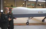 """Illustrative. Iranian Revolutionary Guard Commander Gen. Hossein Salami, left, and the Guard's aerospace division commander Gen. Amir Ali Hajizadeh talk while unveiling a new drone called """"Gaza"""" in an undisclosed location in Iran, in a photo released on May 22, 2021. (Sepahnews of the Iranian Revolutionary Guard, via AP)"""