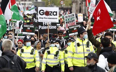 Protesters hold placards and banners in London, Saturday, May 22, 2021, as they take part in a rally supporting Palestinians. (AP Photo/Alastair Grant)