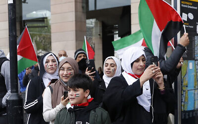 Illustrative -- Protesters hold flags in London, May 22, 2021, as they take part in a pro-Palestinian rally (AP Photo/Alastair Grant)