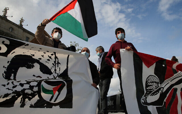 A French demonstrator waves a Palestinian flag as he demonstrates in solidarity with Palestinians in Bayonne, southwestern France, on Saturday, May 22, 2021. (AP Photo/Bob Edme)