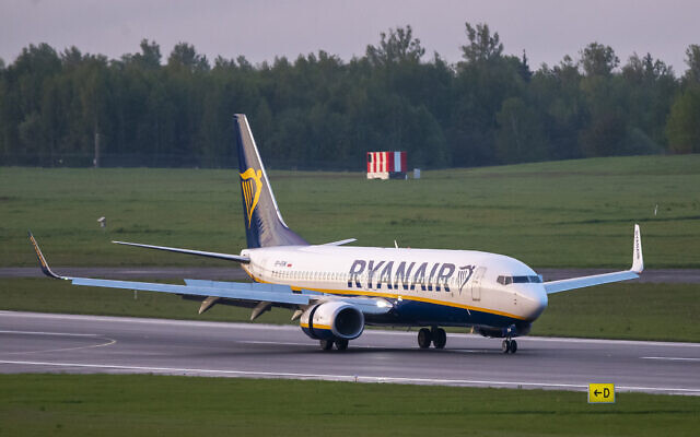 The Ryanair plane with registration number SP-RSM, carrying opposition figure Raman Pratasevich which was traveling from Athens to Vilnius and was diverted to Minsk after a bomb threat, lands at the International Airport outside Vilnius, Lithuania, May 23, 2021.  (AP Photo/Mindaugas Kulbis)