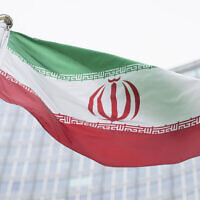 The flag of Iran is seen in front of the headquarters of the International Atomic Energy Agency, in Vienna, Austria, May 24, 2021. (Florian Schroetter/AP)