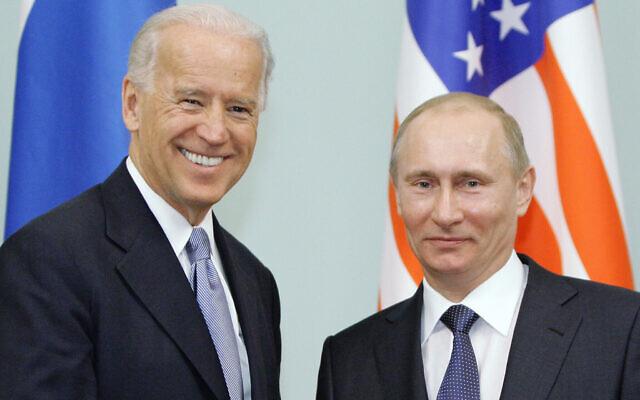 Then-US vice president Joe Biden, left, shakes hands with then-Russian Prime Minister Vladimir Putin in Moscow, Russia, March 10, 2011. (RIA Novosti, Alexei Druzhinin/Pool via AP, file)