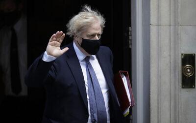 British Prime Minister Boris Johnson waves at the media as he leaves 10 Downing Street in London, May 19, 2021. (AP Photo/Matt Dunham, FILE)