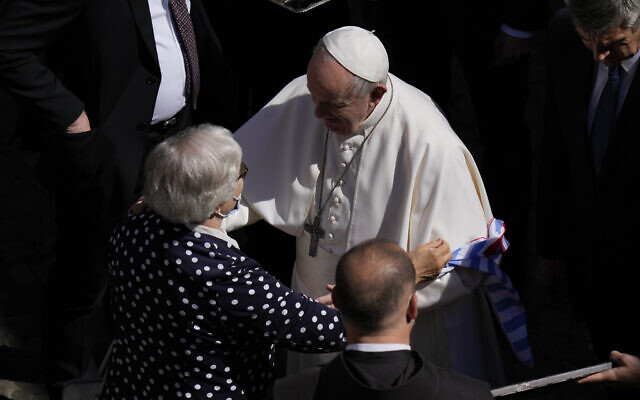 Pope Francis talks with Lidia Maksymowicz, a Holocaust survivor, who was prisoner in the Auschwitz-Birkenau extermination camp, before leaving San Damaso Courtyard at the Vatican for his weekly general audience, May 26, 2021. (AP Photo/Alessandra Tarantino)
