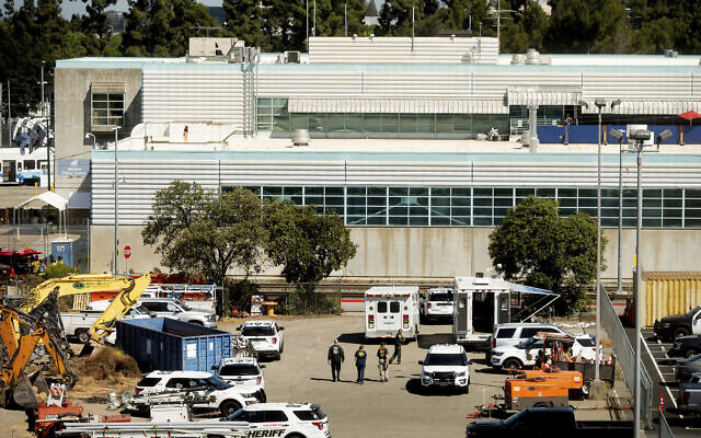 Law enforcement officers respond to the scene of a shooting at a Santa Clara Valley Transportation Authority (VTA) facility on May 26, 2021, in San Jose, California. (AP Photo/Noah Berger)
