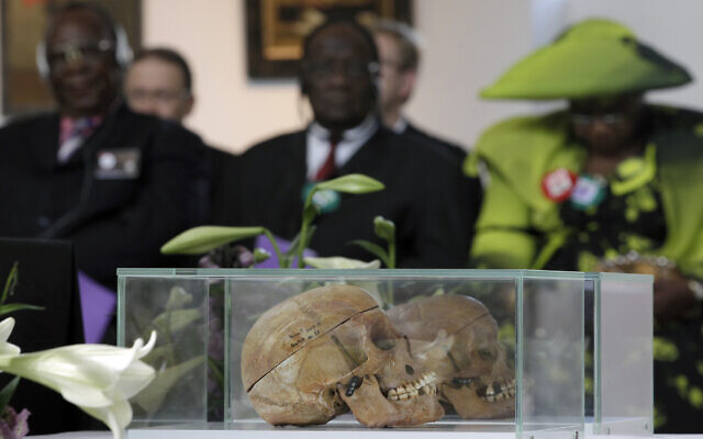 In this Thursday, Sept. 29, 2011 file photo skulls of Ovaherero and Nama people are displayed during a devotion attended by representatives of the tribes from Namibia in Berlin, Germany. Germany has reached an agreement with Namibia that will see it officially recognize as genocide the colonial-era killings of tens of thousands of people and commit to spending a total of 1.1 billion euros ($1.3 billion), largely on development projects. (AP Photo/Michael Sohn)