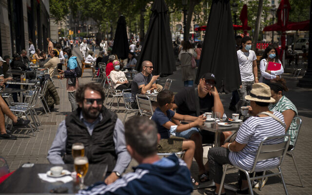 Customers sit in a terrace bar in downtown Barcelona, Spain, May 28, 2021. (AP Photo/Emilio Morenatti, File)