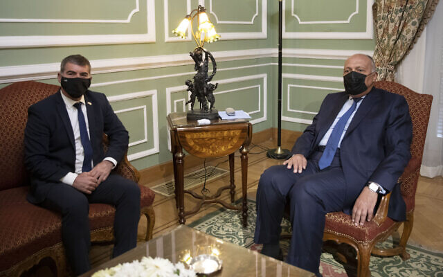 Egyptian Foreign Minister Sameh Shoukry (R) meets with Israeli Foreign Minister Gabi Ashkenazi (L) at the Tahrir Palace in Cairo, Egypt, May 30, 2021. (AP Photo/Nariman El-Mofty)