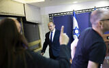 Yamina party leader Naftali Bennett arrives to speak from the Knesset on May 30, 2021, in an address at which he said he was working to firm a unity government with Yesh Atid's Yair Lapid. (Yonatan Sindel/Pool via AP)