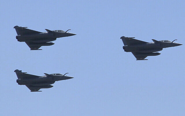 Three French made Rafale fighter jets fly in formation with other Egyptian air force warplanes, above Cairo, on Tuesday, July 21, 2015. Egypt took delivery of three Rafale fighter jets from France, the first of 24 warplanes purchased as part of a nearly $6 billion deal that also included an advanced frigate and munitions. (AP Photo/Ahmed Abd El Latif)