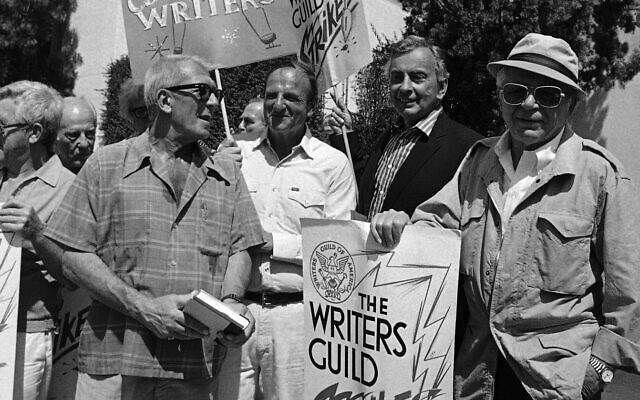 Oscar-winning writers, from left, Richard Brooks, Bo Goldman, Gore Vidal and Billy Wilder join members of the Writers Guild of America during a massive picket outside the 20th Century Fox studios in Los Angeles, June 25, 1981. (AP Photo/ Wally Fong)