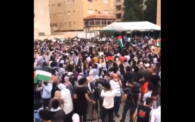 Jordanians protest near the Israeli embassy in Jordan's capital Amman over the pending evictions of several Palestinian families in the East Jerusalem neighborhood of Sheikh Jarrah, May 9, 2021. (Screen capture:)