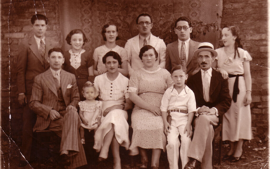 Ruth Behar's grandmother Esther (third from left in front row, in white dress) with her family in Agramonte, Cuba, c. 1936. (Courtesy)