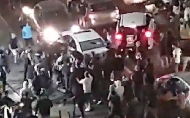 Screen capture from video of a crowd of Jewish protestors pulling an Arab man from his vehicle in Bet Yam, May 21, 2021. (Twitter)