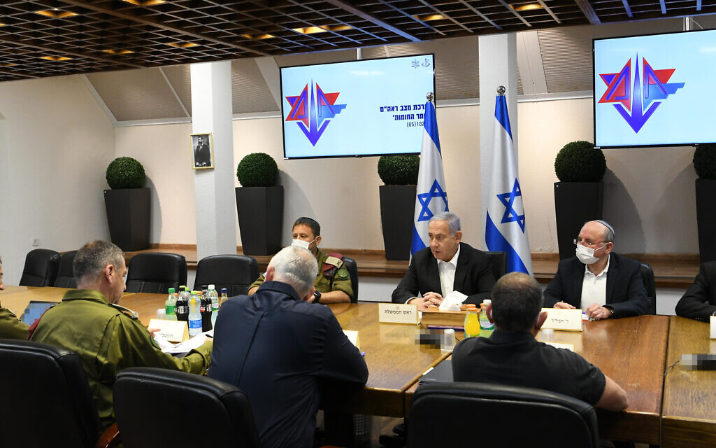 Prime Minister Benjamin Netanyahu, center, facing camera, and other top officials holding security consultations at defense headquarters in Tel Aviv on May 10, 2021. (Amos Ben Gershom/GPO)