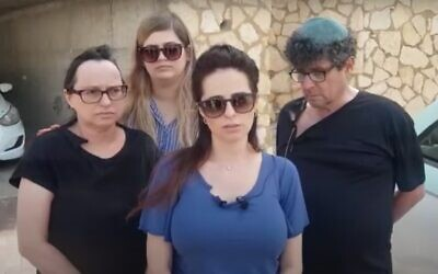 Screen capture from video Ella Gordon, center, and other family members as during a press briefing about the killing of her brother, Efraim, who was shot dead in the US, seen on May 5, 2021. (YouTube)