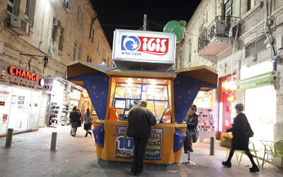"""Illustrative: An Israeli man at a """"lotto"""" booth in the center of Jerusalem. (Miriam Alster/Flash90)"""