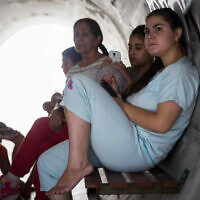 Illustrative image: Children sit together inside a street shelter, in anticipation of the Code Red siren alerting of incoming rockets, in the Southern Israeli town of Nitzan, on the fourth day of Operation Protective Edge, July 11, 2014. (Flash 90)