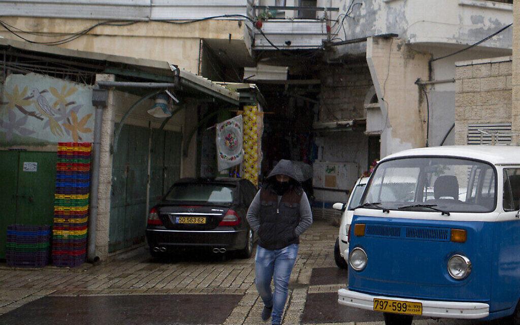 Illustrative: A man walks in a mostly empty market in Nazareth, on January 26, 2016. (Lior Mizrahi/Flash90)