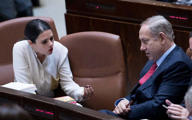 Prime Minister Benjamin Netanyahu, right, speaks with then Justice Minister Ayelet Shaked in the Knesset, December 21, 2016. (Yonatan Sindel/Flash90)