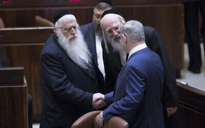 Prime Minister Benjamin Netanyahu, right, shake hands with United Torah Judaism parliament members Yisrael Eichler, center and Meir Porush in the Knesset, January 25, 2019. (Yonatan Sindel/Flash90)
