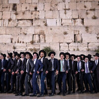 Ultra-Orthodox Jewish men dance at the end of the Jewish holiday of Shavuot, at the Western Wall, in the Old City of Jerusalem on June 9, 2019. (Aharon Krohn/Flash90)