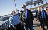 Minister of Public Security Amir Ohana and acting Police Chief Kobi Shabtai visit a temporary roadblock on Route 1 outside Jerusalem on January 8, 2021. (Yonatan Sindel/Flash90)