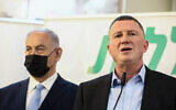 Prime Minister Benjamin Netanyahu (L) and Health Minister Yuli Edelstein, seen during a visit at the COVID-19 vaccination center in Zarzir, northern Israel, February 9, 2021. (David Cohen/Flash90)