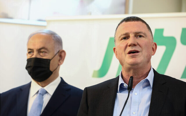 Prime Minister Benjamin Netanyahu (left) and Health Minister Yuli Edelstein, seen during a visit at the COVID-19 vaccination center in Zarzir, northern Israel, on February 9, 2021. (David Cohen/Flash90)