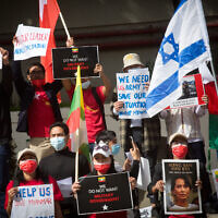 Myanmarese residents in Israel protest agaisnt the military coup wich took place in Myanmar, outside The Chinese Embassy in Tel Aviv on February 15, 2021. (Miriam Alster/Flash90)