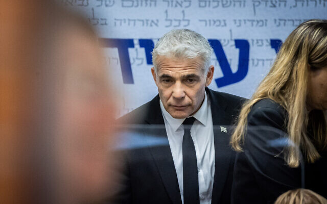 Head of the Yesh Atid party Yair Lapid seen after a faction meeting at the Knesset on April 26, 2021. (Yonatan Sindel/Flash90)