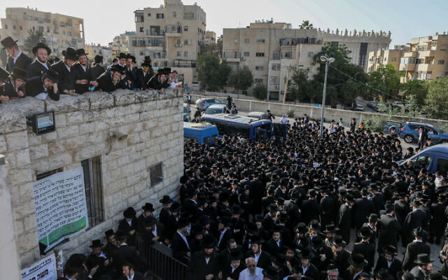 Hundreds of ultra-Orthodox attend the Jerusalem funeral of one of the victims of the Meron tragedy, where 45 people were crushed to death, April 30, 2021 (Olivier Fitoussi/Flash90)