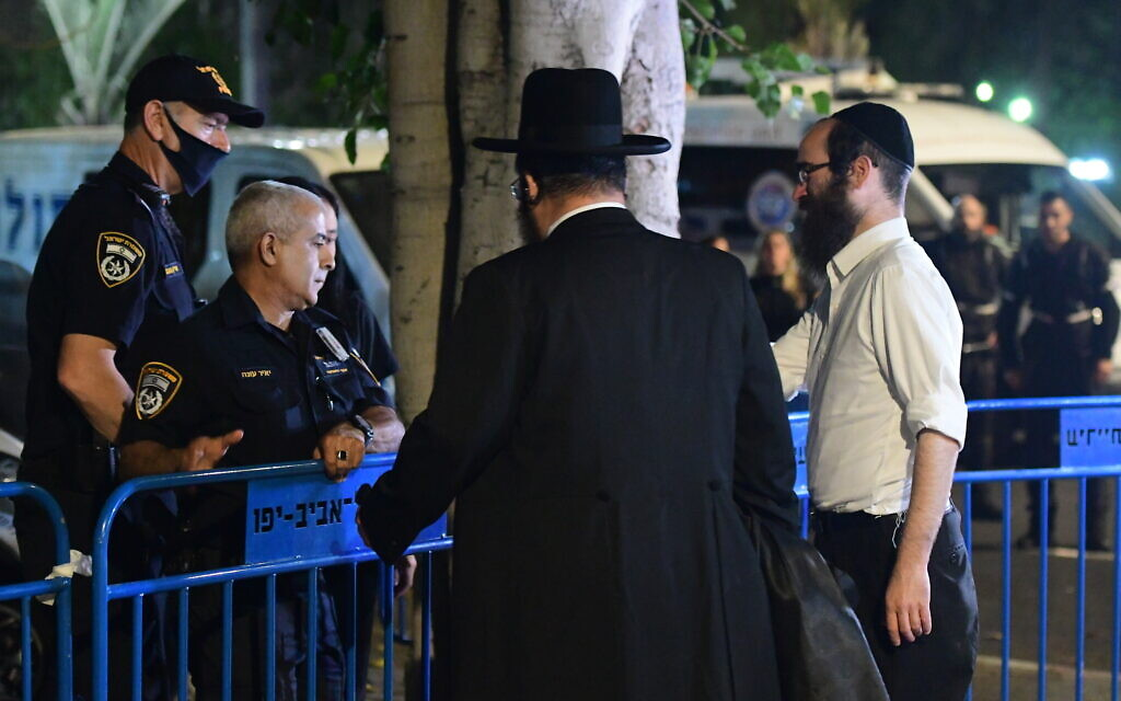 Relatives of those killed in the Mount Meron disaster are seen outside the Institute of Forensic Medicine in Tel Aviv, where the bodies of the 45 victims were taken for identification, May 1, 2021. (Avshalom Sassoni/Flash90)