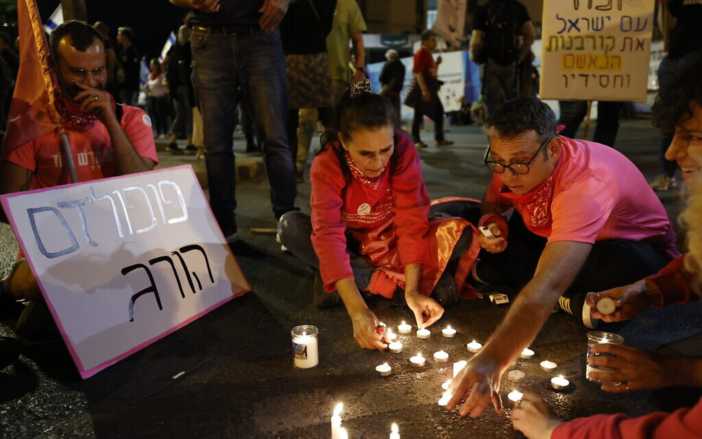 Anti-Netanyahu protesters light candles for the 45 victims who were killed in the deadly crushing at Mount Meron during Lag B'Omer celebrations, at the weekly protest outside the Prime Minister's Residence in Jerusalem, May 1, 2021. (Yonatan Sindel/Flash90)