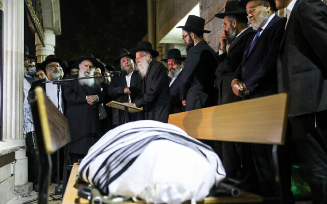 People attend the funeral of Yossi Kohn, one of the victims of the Meron tragedy, where 45 people were crushed to death, outside the Mir Yeshiva in Jerusalem, May 2, 2021. (Noam Revkin Fenton/Flash90)